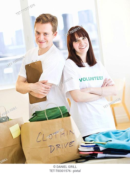 Portrait of volunteers organizing clothing drive