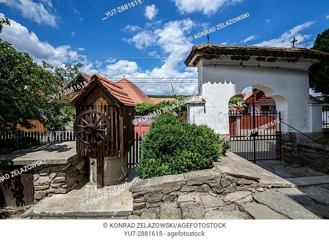 Wooden well of Holy Trinity Church in small village of Sibiel famous from traditional Saxon architecture in Saliste commune, Transylvania in Romania
