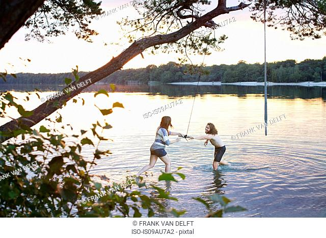 Young couple playing in lake