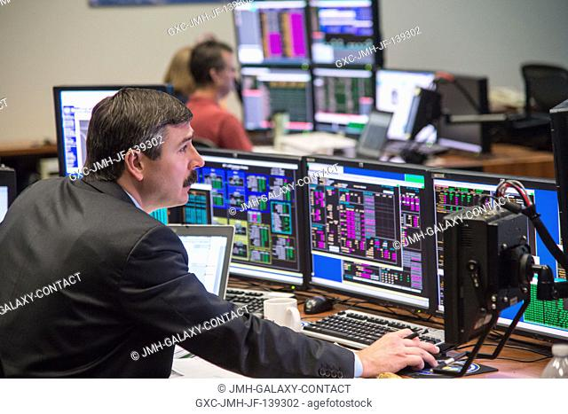 Flight director Mike Sarafin studies a simulated scene on a computermonitor, as a flight control team of about two dozen JSC-based personnel continues its...
