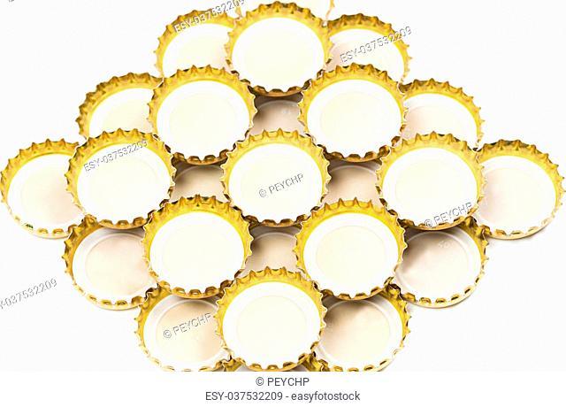 Golden bottle caps isolated on white background