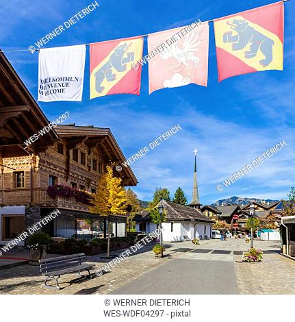 Switzerland, Canton of Bern, Gstaad, pedestrian area and chapel