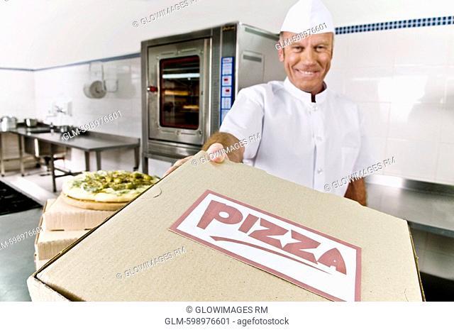 Chef holding a pizza box