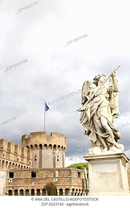 statue of an angel standing on the bridge leading to the Castle Sant'Angelo, Rome