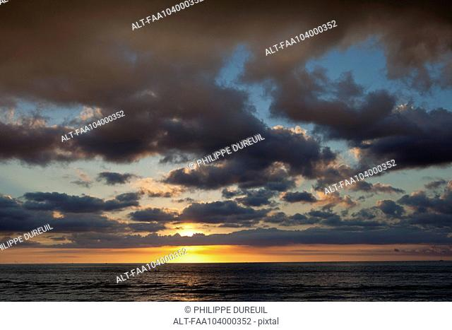 Cloudy sky over sea during sunset
