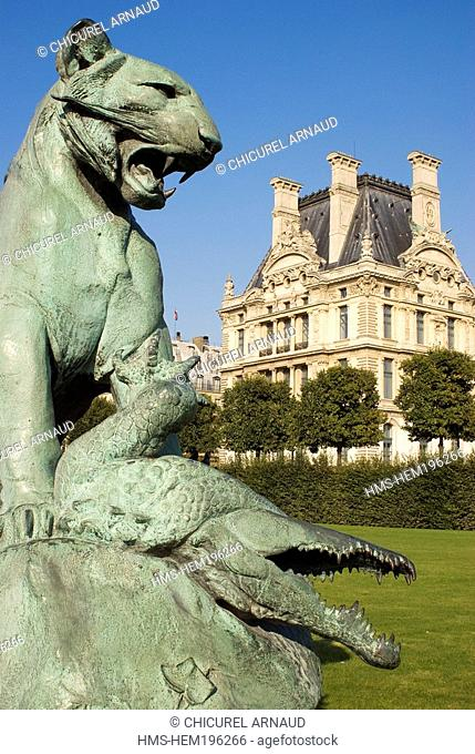 France, Paris, Les Tuileries gardens, sculpture the Tiger and the Crocodile by Auguste Cain 1873 and the Louvre Museum in the background