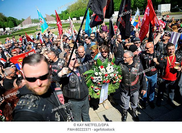 Members of the offshoot of the motorcycle gang 'Night Wolves' commemorate the end of World War Two at the Soviet memorial in Treptow in Berlin, Germany