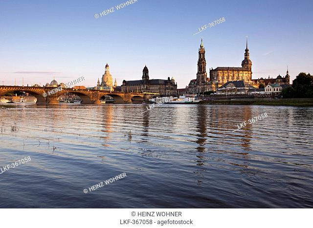 Canaletto view, view over the Elbe river to Augustus bridge, Frauenkirche, Staendehaus, Hofkirche and Dresden castle in the evening light, Dresden, Saxonia