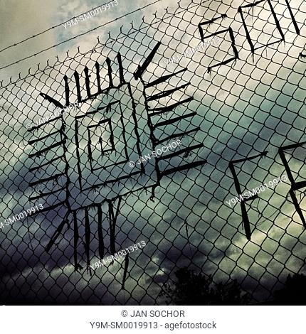 A quadrate spiral sign made of ribbons is seen on the chain link fence on the street of Quito, Ecuador, 5 June 2014