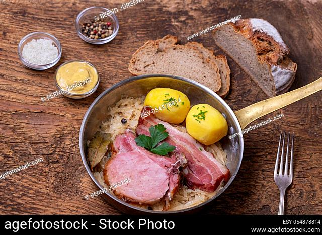 closeup of a french choucroute dish on wood