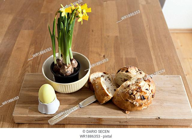 Easter decoration, bread, painted egg and daffodils, Munich, Bavaria, Germany