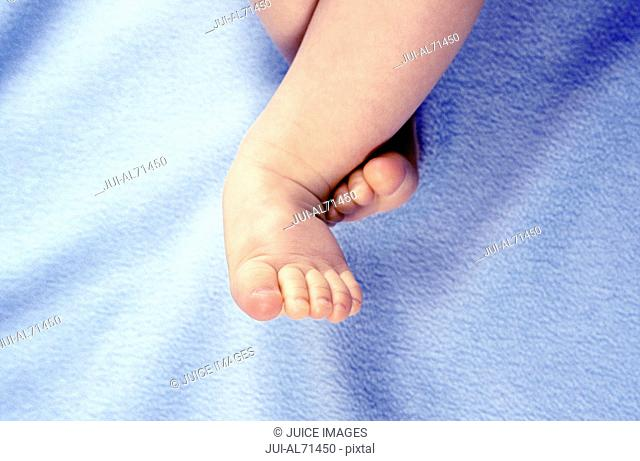High angle portrait of a baby lying on a white towel