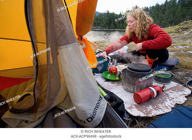 Woman in tent, camping at Kunechin Point, Sechelt Inlet. Gibsons, Sunshine Coast, British Columbia, Canada