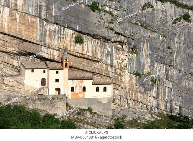 A view of Eremo di San Colombano, a monastery in Trambileno, Province of Trento, Italy, notable for its location in the side of a mountain