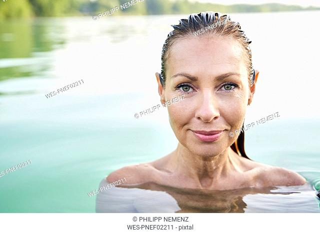 Portrait of mature woman in a lake