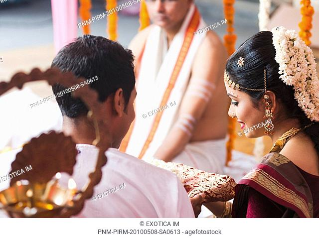 Bridegroom giving a sari to the bride at the South Indian wedding ceremony