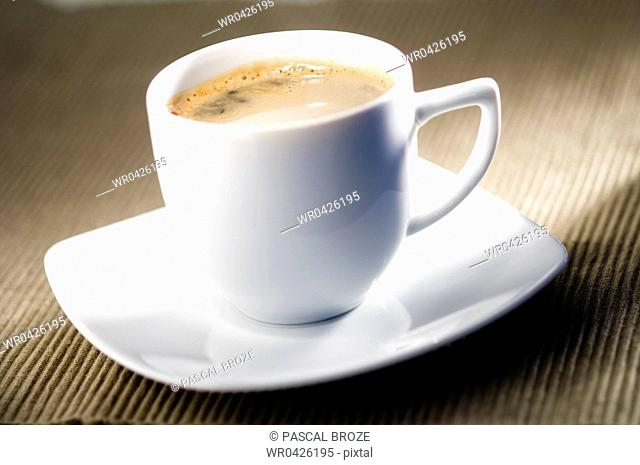 Close-up of a cup of espresso coffee with a saucer
