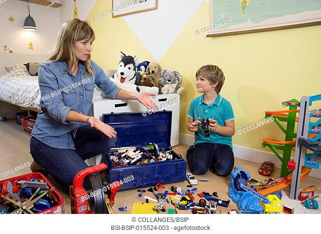 A mother asking her son to tidy his room