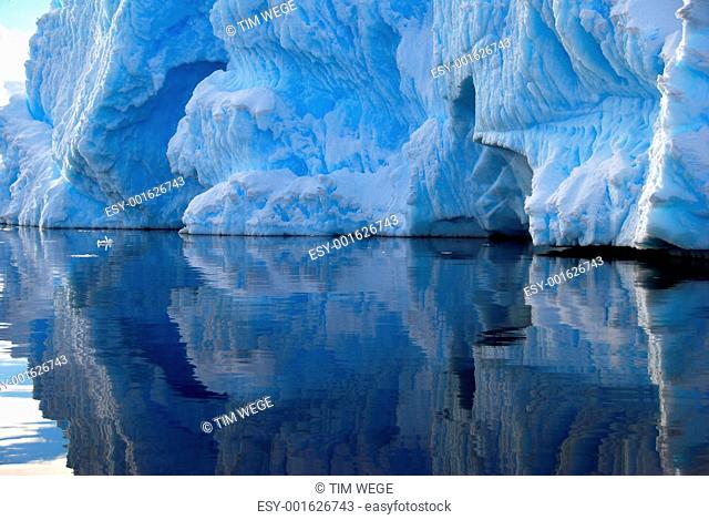 iceberg detail reflected in the sea