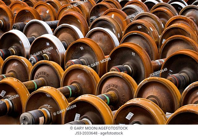 Railroad train wheel and axle assemblies at manufacturing plant, Tacoma, Washington USA
