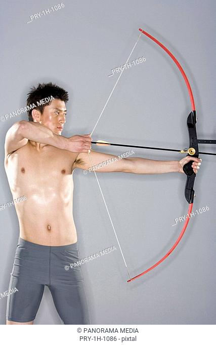 a man practicing archery