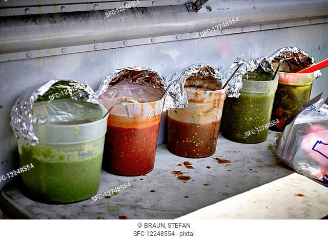 Various sauces for burritos in a street kitchen (USA)