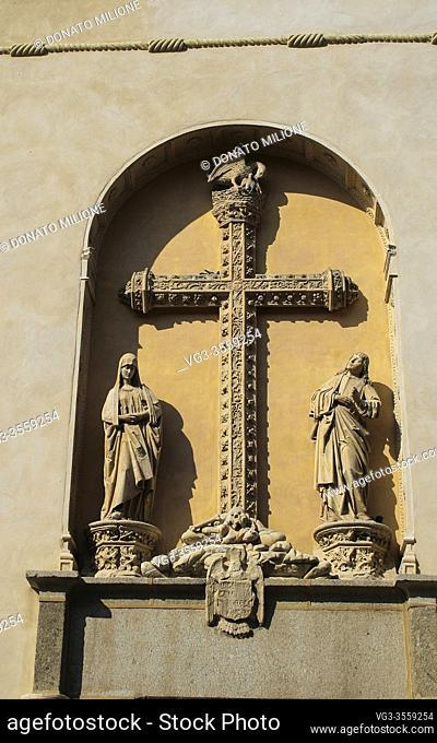 """Toledo, Castilla-La Mancha, Spain, Europe. Monastery of San Juan de los Reyes ((1477â. """"1504). The sculptures over the door in the Calles de los Reyes Catolicos"""