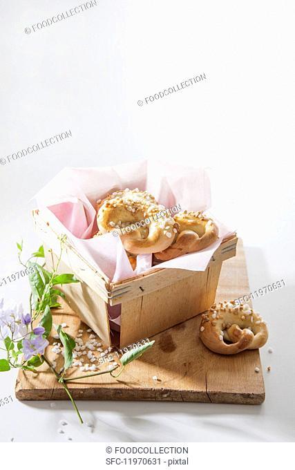 Sweet pretzels in a wooden basket