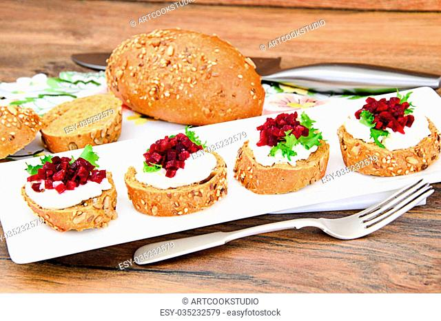 Bruschetta with Goat Cheese, Arugula and Beet, Salt, Pepper, Honey Studio Photo