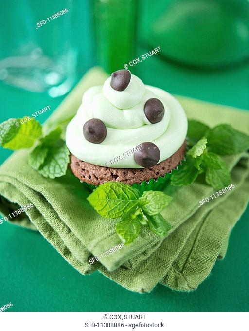 A mint chocolate chip cupcake