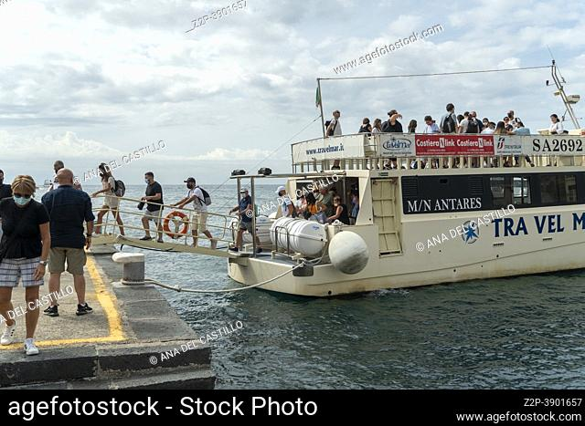Amalfi coast from the sea in Campania region Italy 1. Boat with tourists in the port