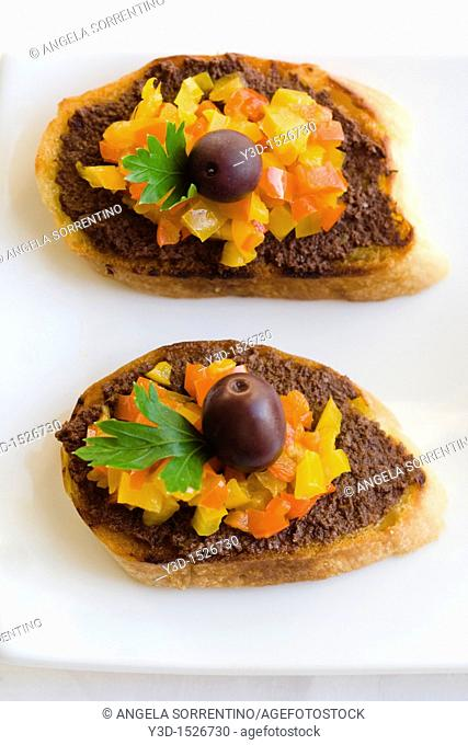 Bruschetta with peppers and olives, finger food