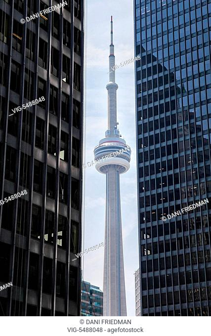 CANADA, TORONTO, 29.05.2016, The CN Tower framed between two large office buildings located in the financial district in downtown Toronto, Ontario, Canada