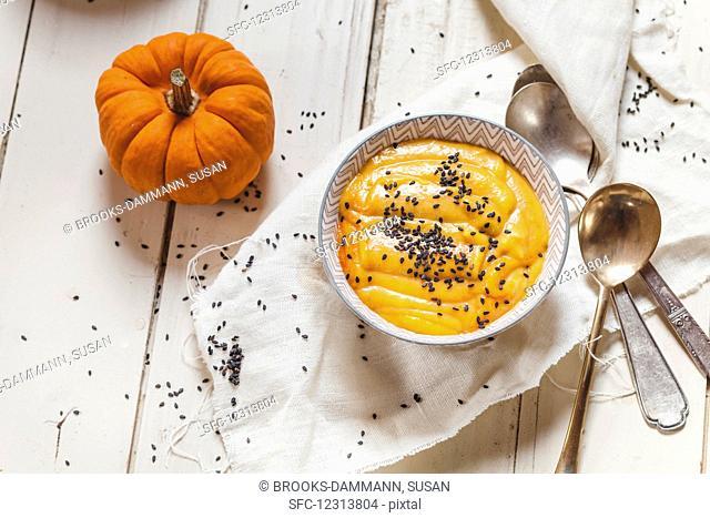 Pumpkin soup with black sesame seeds