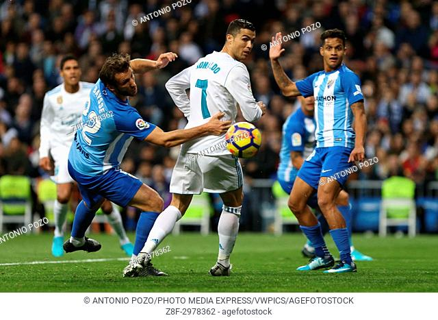MADRID, SPAIN. November 25, 2017 - Cristiano Ronaldo and Paul Baysse looking for the ball. Real Madrid have chalked up an important victory, 3-2