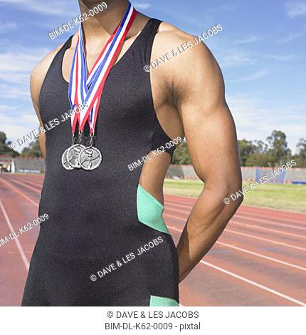 African male athlete with medals, Perth, Australia