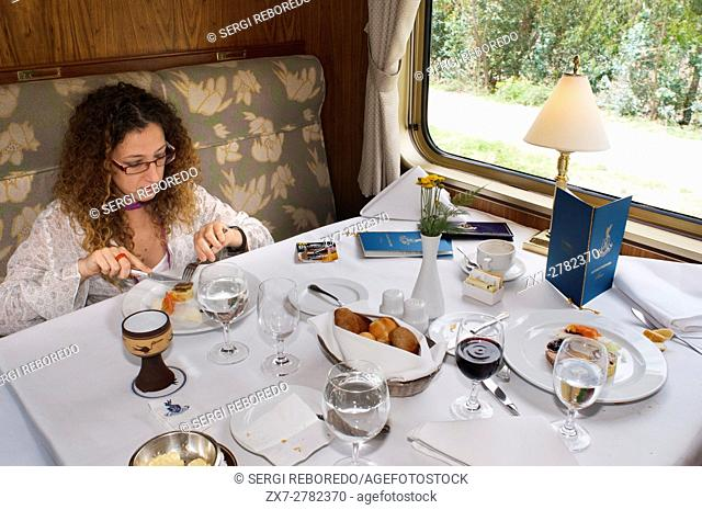 Peru Luxury train from Cuzco to Machu Picchu. Orient Express. Belmond. The waiters serve delicacies inside the Hiram Bingham Orient Express which runs between...