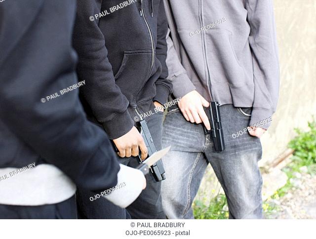 Men holding guns and knife