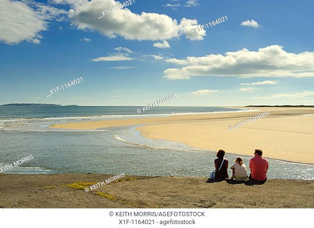 A family admiring the view on a sunny day at The Millennium Coastal park, Burryport, Carmarthenshire South Wales UK