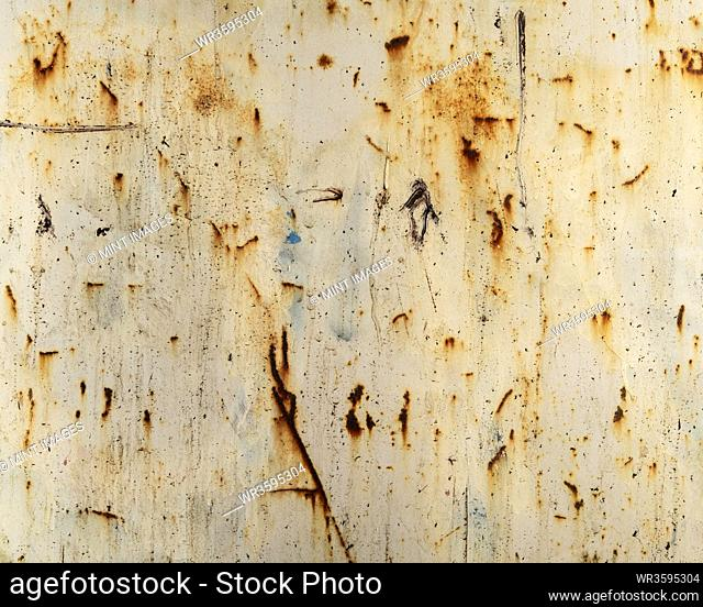 Close up of rusty industrial wall, focus on scratch marks