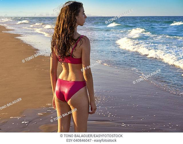 Bikini girl in the beach blue shore at summer Mediterranean sea