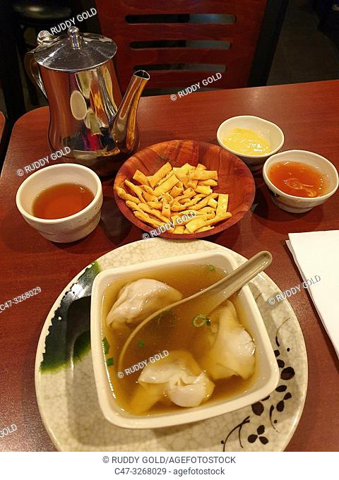 Won ton soup. In Chinese cooking a dumpling filled with minced pork and spices, usually boiled in and served with soup, Financial District
