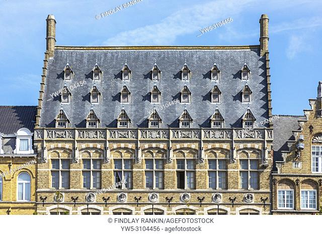 Flemish architecture with attic windows and ornate arches in the Old Seignory building, Grote Markt, Ypres, Belgium