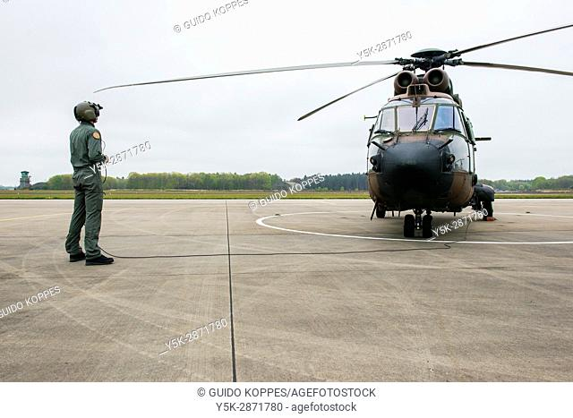 Gilze-Rijen, Netherlands. Military Cougar helicopter taking of and departing from an airbase platform