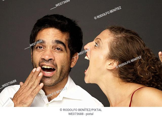 Woman screaming at a man while he doesn't seem to care or listen