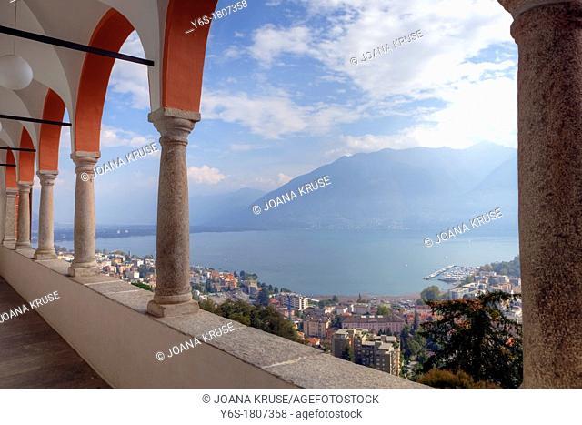 Overlooking Lake Maggiore by the arches of the Sanctuary of Madonna del Sasso, Locarno, Ticino, Switzerland