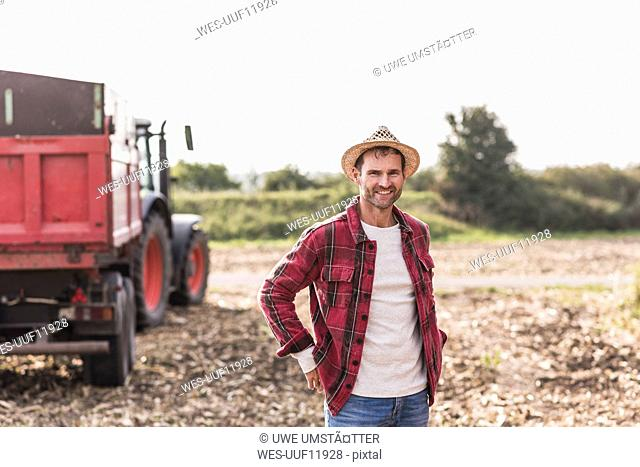 Portrait of confident farmer on field