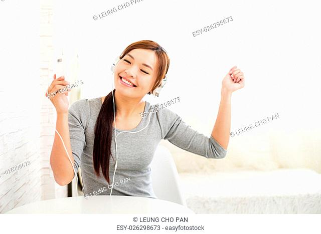 Excited woman listen to music