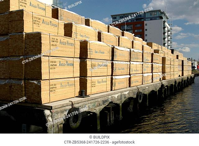 Timber load stacked at a dock, Ipswich, UK