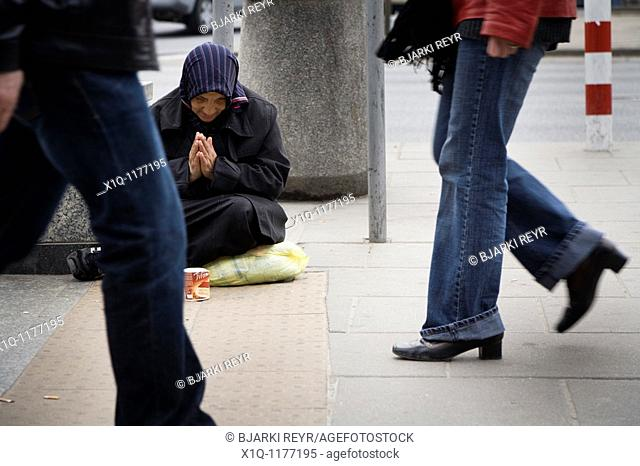 Woman begging for money, Warsaw Poland